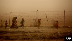 Syrian children at a temporary refugee camp in Syria